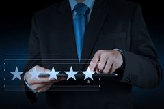 Five stars 5 rating with a businessman is touching virtual computer. Screen.For positive customer feedback and review with excellent performance royalty free stock photos