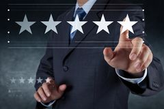 Five stars 5 rating with a businessman is touching royalty free illustration