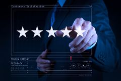 Five stars 5 rating with a businessman is touching virtual computer screen. For positive customer feedback and review with excellent performance royalty free stock image