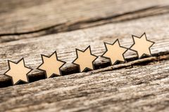 Five stars on a rustic wooden boards Stock Photography