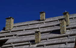 Five stone chimneys Royalty Free Stock Photography