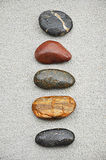 Five stones. On concrete ground Royalty Free Stock Images