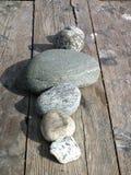 Five stones aligned to the sun. stock photo