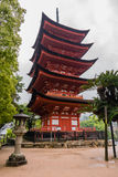 Five-storied Pagoda (Gojunoto) on Miyajima Island. Miyajima, Japan - May 6, 2016: Five-storied Pagoda (Gojunoto) on Miyajima Island. Miyajima island is a famous stock image