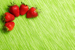 Five strawberries in corner Stock Photography