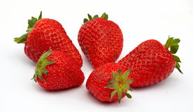 Five Strawberries, focus on the strawberry in front royalty free stock photography
