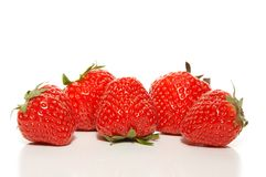 Five strawberries in a row Stock Photography