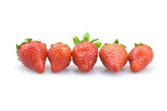 Five strawberry. Five fresh strawberries arranged in a discharge of a white background Royalty Free Stock Image