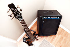 Five string bass guitar and amplifier Royalty Free Stock Photos