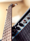 Five string bass guitar and amplifier Stock Images