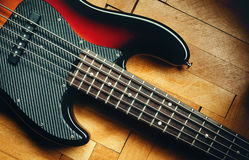Five Strings Jazz Bass. Details of a five strings bass on parquet, classical jazz design Royalty Free Stock Image