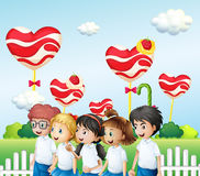 Five students at the candyland Stock Images