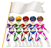 Five superheroes and an empty banner Royalty Free Stock Image