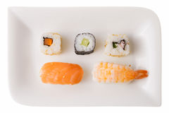 Five sushi rolls on a plate. Sushi rolls. From left to right, top to bottom: California roll carrot, Makizushi cucumber, California roll, Nigiri Sushi salmon Royalty Free Stock Photography