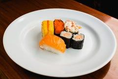 Five Sushi on white dish. Sushi set on white dish Royalty Free Stock Images