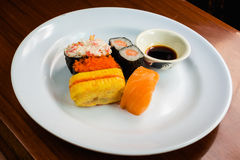 Five Sushi on white dish. Sushi set on white dish Royalty Free Stock Photos