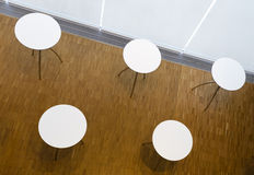 Five tables with circular white tabletop Stock Photos