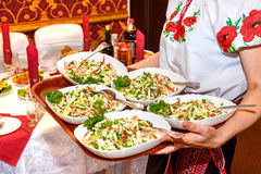 Five tables of salad in female hands Stock Photos