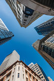Five tall buildings upright. Five tall buildings viewed from bottom looking up with blue sky during the day Stock Photos