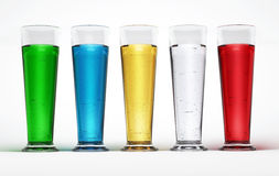 Five tall glasses full of Multicolored liquids. Royalty Free Stock Images
