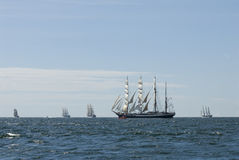 Five tall ships and horizon. Five formidable windjammers at The Tall Ships´Races start.  Fullriggers Sørlandet and Dar Młodzieży, barques Statsraad Lehmkuhl Royalty Free Stock Photos
