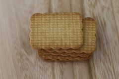 Tasty and sweet biscuits on wooden desk stock photography