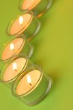 Five tea lights, green. Five tea lights on green background Stock Photos