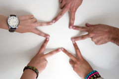 Five teenagers hands form a star Royalty Free Stock Photos