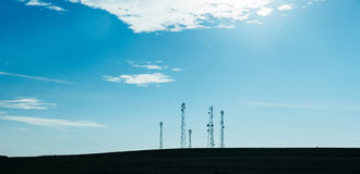 Five telecommunication mast TV antennas Royalty Free Stock Photo
