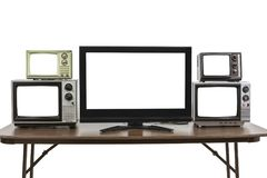 Five Televisions on Table  on White Stock Images