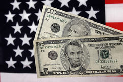 Five and Ten. Photo of a Five and Ten Dollar Bill With American Flag Background royalty free stock photos