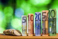 Five, ten, twenty, fifty and one hundred euro rolled bills bankn Royalty Free Stock Images
