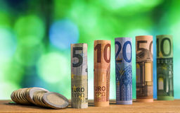 Five, ten, twenty, fifty and one hundred euro rolled bills bankn Royalty Free Stock Photography