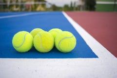 Five tennis balls royalty free stock image