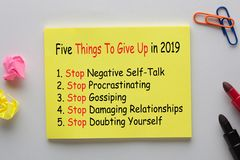 Five Things To Give Up in 2019. Written on note with marker pen and various stationery stock photography