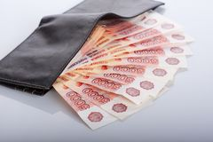 Five thousand roubles in black leather wallet Stock Image