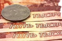 Five thousand ruble notes and five-ruble coin Stock Images