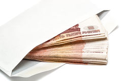 Five thousand Russian banknotes in envelope. On white background Stock Image