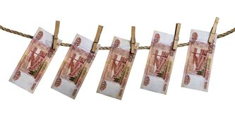 Russian rouble banknotes hanging on a clothesline with clothes pegs isolated on white background. Five thousand russian rouble banknotes hanging on a clothesline Stock Photos