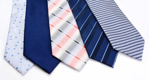 Five ties   on a white Stock Photos