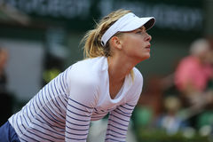 Five times Grand Slam champion Maria Sharapova in action during her second round match at Roland Garros 2015. PARIS, FRANCE- MAY 27, 2015:Five times Grand Slam Stock Photos