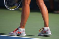 Five times Grand Slam champion Mariya Sharapova wears custom Nike tennis shoes during match at US Open 2014. NEW YORK - AUGUST 31 Five times Grand Slam champion Stock Photo