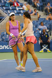 Five times Grand Slam champion Martina Hingis and Flavia Pennetta during final doubles match at US Open 2014 Stock Photo