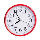 Five to eight on a round clock face Stock Images