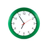 Five to seven on big wall clock Royalty Free Stock Image