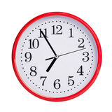 Five to seven on a round clock face Royalty Free Stock Photography