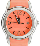 Five to twelve o'clock on dial orange wristwatch Royalty Free Stock Photography