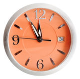 Five to twelve o'clock on orange dial isolated Royalty Free Stock Photography