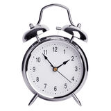 Five to two on a round alarm clock Royalty Free Stock Photography