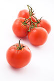 Five tomatoes. Brunch of five sweet tomatoes on white background Royalty Free Stock Images